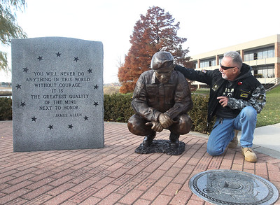 Candace H. Johnson-For Shaw Media Wayne J. Maczko, of Fox Lake, retired HVAC engineer, CLC Facilities Department and project ambassador looks at the bronze sculpture of a veteran which is part of the CLC Salute to Veterans plaza during the Veterans Day and Dedication Ceremony at the College of Lake County in Grayslake. (11/5/18)