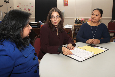 Candace H. Johnson-For Shaw Media Laura Rios, of Gurnee, program manager, (center) talks with Cynthia Grace Antonio and Maria E. Gonzalez, both of Waukegan about their involvement with the Parents Educating Parents program and their workshop curriculums at Waukegan to College on the second floor of the Christ Episcopal Church in Waukegan. Antonio teaches High School Options and Transition and Gonzalez teaches the Four-Year-Plan workshop in Spanish. (11/6/18)
