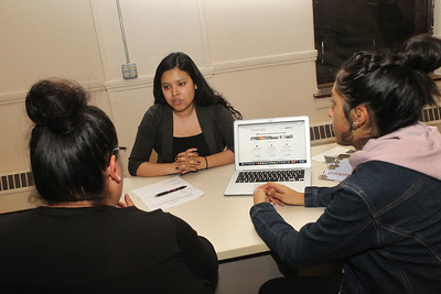 "Candace H. Johnson-For Shaw Media Daisy Hernandez, program associate, talks with Maribel Serna and her daughter, Gabriela, 15, all of Waukegan, during their monthly meeting about ""My Next Move,"" a free career research and planning website at Waukegan to College on the second floor of the Christ Episcopal Church in Waukegan. (11/6/18)"
