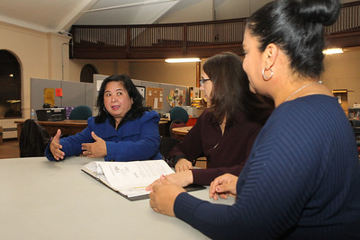 Candace H. Johnson-For Shaw Media Cynthia Grace Antonio, of Waukegan talks with Laura Rios, of Gurnee, program manager, and Maria E. Gonzalez, of Waukegan about her experience getting involved with the Parents Educating Parents program at Waukegan to College on the second floor of the Christ Episcopal Church in Waukegan. Antonio teaches High School Options and Transition and Gonzalez teaches the Four-Year-Plan workshop in Spanish.(11/6/18)