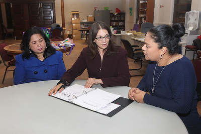 Candace H. Johnson-For Shaw Media Laura Rios, of Gurnee, program manager, (center) talks with Cynthia Grace Antonio and Maria E. Gonzalez, both of Waukegan about their involvement with the Parents Educating Parents program at Waukegan to College on the second floor of the Christ Episcopal Church in Waukegan. Antonio teaches High School Options and Transition and Gonzalez teaches the Four-Year-Plan workshop in Spanish. (11/6/18)
