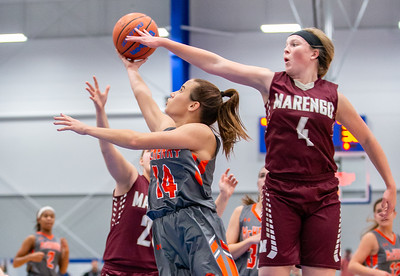 McHenry's Jamie Howe (Left) is fouled by Marengo's Hannah Ritter (right) Monday, November 12, 2018 at the Burlington Central Girls Basketball Tournament in Burlington. A close game through three quarters but McHenry pulled away in the fourth and took the victory 58-43. KKoontz – For Shaw Media
