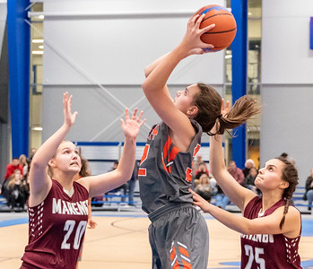 McHenry's Katie Beyer (Center) goes up for the shot against Marengo's Erin Haeflinger (Left) and Marissa Knobloch (Right) Monday, November 12, 2018 at the Burlington Central Girls Basketball Tournament in Burlington. McHenry wins 58-43 with Beyer finishing the night with 23 points. KKoontz – For Shaw Media
