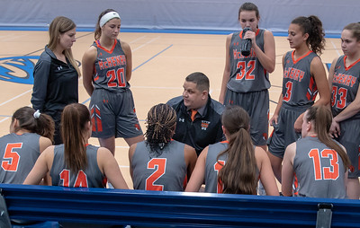 McHenry girls head basketball coach Rob Niemic talks with his team during a timeout Monday, November 12, 2018 at the Burlington Central Girls Basketball Tournament in Burlington. A close game through three quarters but McHenry pulled away in the fourth and took the victory 58-43. KKoontz – For Shaw Media