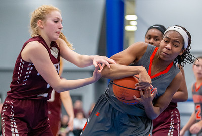 Marengo's Jennifer Heinberg (Left) and McHenry's Izzy Gscheidle (Right) fight for possession of the ball Monday, November 12, 2018 at the Burlington Central Girls Basketball Tournament in Burlington. A close game through three quarters but McHenry pulled away in the fourth and took the victory 58-43. KKoontz – For Shaw Media