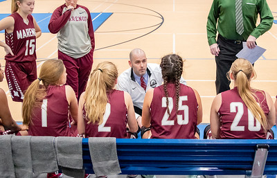 Marengo girls head basketball coach Nick Rode talks with his team during a timeout Monday, November 12, 2018 at the Burlington Central Girls Basketball Tournament in Burlington. A close game through three quarters but McHenry pulled away in the fourth and took the victory 58-43. KKoontz – For Shaw Media