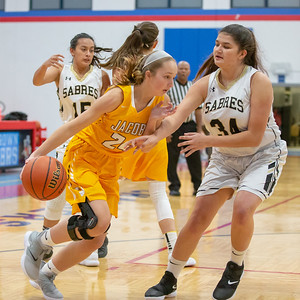 Jacobs High School Junior Liz Schwartz drives the baseline against Streamwood's Alexis Rojas Wednesday, November 14, 2018 at the Dundee-Crown Thanksgiving Girls Basketball Tournament in Carpentersville. Schwartz finished with 12 points in the 54-45 loss. KKoontz – For Shaw Media