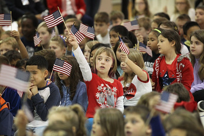 "Candace H. Johnson-For Shaw Media Second-grade student Abigail McNulty, 8, waves an American flag to the song, ""Thank A Vet,"" during the Veterans Day Celebration at the William L. Thompson Elementary School in Lake Villa. (11/12/18)"