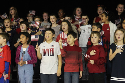 "Candace H. Johnson-For Shaw Media Fourth-grade students sing the ""Star-Spangled Banner"" during the Veterans Day Celebration at the William L.Thompson Elementary School in Lake Villa. (11/12/18)"
