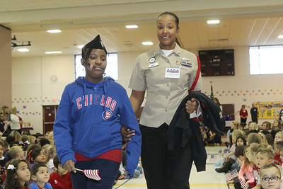 Candace H. Johnson-For Shaw Media Fourth-grade student Layla Isom, 9, walks with her aunt, Chelsea Satchell, both of Lake Villa, a Navy veteran, as she is recognized for her service during the Veterans Day Celebration at the William L. Thompson Elementary School in Lake Villa. (11/12/18)