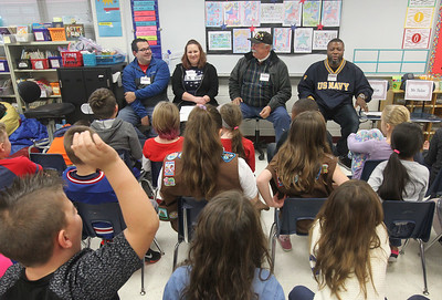Candace H. Johnson-For Shaw Media Navy veterans Scott and Brittany Hubler, of Round Lake Beach, Army veteran John Mann, of Deerfield and Navy veteran Robert James, Jr., of Round Lake Beach answer questions from second-grade students in Miss Katie McShane's classroom during the Veterans Day Celebration at the William L.Thompson Elementary School in Lake Villa. (11/12/18)