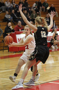 Candace H. Johnson-For Shaw Media Grant's Katelyn Flader drives to the basket against Grayslake North's Grace Wamser in the first quarter during the Girls Thanksgiving Basketball Tournament at Mundelein High School. Grant won 58-40. (11/12/18)