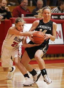 Candace H. Johnson-For Shaw Media Grant's Nicolette Kouvelias battles for control with Grayslake North's Faith Standerski in the first quarter during the Girls Thanksgiving Basketball Tournament at Mundelein High School. Grant won 58-40. (11/12/18)