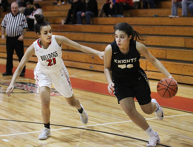 Candace H. Johnson-For Shaw Media Grayslake North's Jayden Curtis (on right) drives to the basket against Grant's Katelyn Dupree in the third quarter during the Girls Thanksgiving Basketball Tournament at Mundelein High School. Grant won 58-40. (11/12/18)