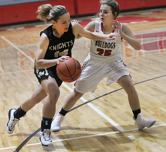 Candace H. Johnson-For Shaw Media Grayslake North's Faith Standerski looks to drive around Grant's Nicolette Kouvelias in the first quarter during the Girls Thanksgiving Basketball Tournament at Mundelein High School. Grant won 58-40. (11/12/18)