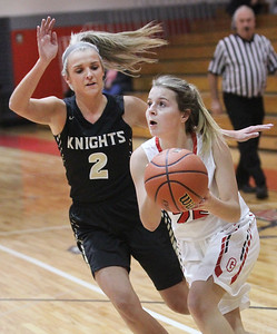 Candace H. Johnson-For Shaw Media Grayslake North's Jordyn Gerdes tries to block a shot by Grant's Nicolette Kouvelias in the first quarter during the Girls Thanksgiving Basketball Tournament at Mundelein High School. Grant won 58-40. (11/12/18)