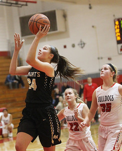 Candace H. Johnson-For Shaw Media Grayslake North's Savannah Guenther goes up for a shot past Grant's Katelyn Flader and Jazzlyn Linbo in the third quarter during the Girls Thanksgiving Basketball Tournament at Mundelein High School. Grant won 58-40. (11/12/18)