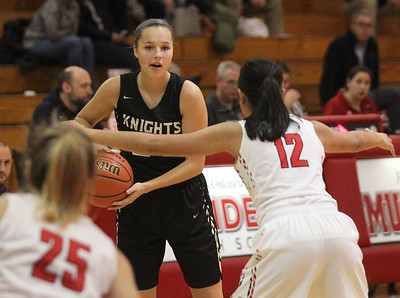 Candace H. Johnson-For Shaw Media Grayslake North's Savannah Guenther looks to drive around Grant's Nicolette Kouvelias and Ally Mahinay in the third quarter during the Girls Thanksgiving Basketball Tournament at Mundelein High School. Grant won 58-40. (11/12/18)