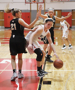 Candace H. Johnson-For Shaw Media Grant's Jazzlyn Linbo drives to the basket against Grayslake North defenders Morgan Atwell and Jordyn Gerdes in the second quarter during the Girls Thanksgiving Basketball Tournament at Mundelein High School. Grant won 58-40. (11/12/18)