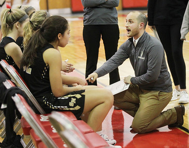 Candace H. Johnson-For Shaw Media Grayslake North's Rob Nicoletti, head coach, talks with his varsity girls basketball players in a timeout in the fourth quarter against Grant during the Girls Thanksgiving Basketball Tournament at Mundelein High School. Grant won 58-40. (11/12/18)