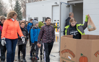 Alyson Kramer (right) and other students from the Hanna Beardsley Middle School drop off food items at the Crystal Lake Food Pantry Friday, November 16, 2018 in Crystal Lake.  KKoontz – For Shaw Media