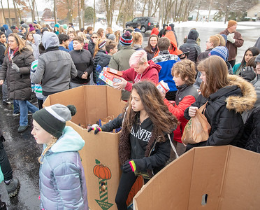 Students from the Hanna Beardsley Middle School drop off food items at the Crystal Lake Food Pantry Friday, November 16, 2018 in Crystal Lake.  KKoontz – For Shaw Media
