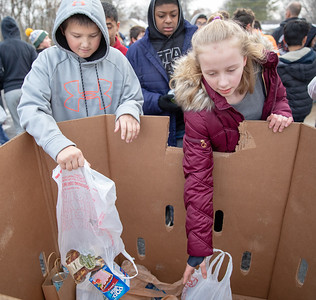 Hanna Beardsley Middle School students Adrian Pekalski (Left and Keora McMullen drop off food items at the Crystal Lake Food Pantry Friday, November 16, 2018 in Crystal Lake.  KKoontz – For Shaw Media