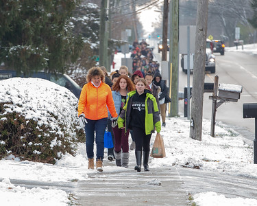 Students from Hanna Beardsley Middle School make their way to the Crystal Lake Food Pantry carrying donated food items Friday, November 16, 2018 in Crystal Lake.  KKoontz – For Shaw Media