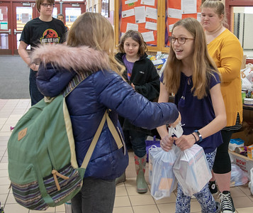 Sixth-grader Katherine Witt (right) collects food donation at Hanna Beardsley Middle School Friday, November 16, 2018 in Crystal Lake. The items collected were then donated to the Crystal Lake Food Pantry.  KKoontz – For Shaw Media