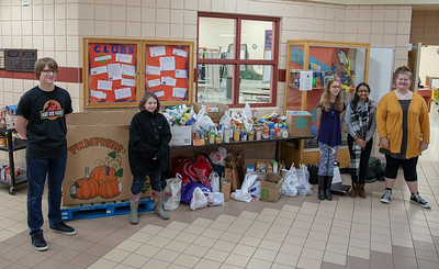 Hanna Beardsley Middle School student council members Zander Marino (8th Grade), Evelyn Mahler (6th Grade) Katherine Witt, Riya Gumidyala (6th Grade), Paris Lotito (8th Grade) wait for incoming food donations Friday, November 16, 2018 in Crystal Lake. The food drive, organize by the Student Council members benefitted the The Crystal Lake Food Pantry.
