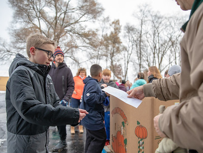 Seventh-grader Kyle Defort from Hanna Beardsley Middle School drops off a monetary donation to the Crystal Lake Food Pantry Friday, November 16, 2018 in Crystal Lake. KKoontz – For Shaw Media