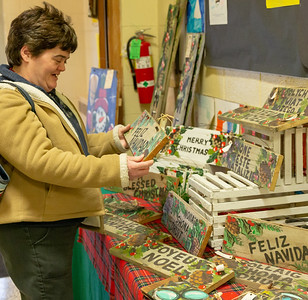 Stephanie Hansen of McHenry checks out the hand-painted crafts at the St. Mary's 2nd Annual Kris Kringle Market Saturday, November 17, 2018 in McHenry. KKoontz – For Shaw Media