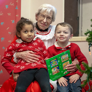 Mrs. Claus reads Lareina Bell (4yrs) (Left) and Andrew Zabinsky (4yrs) (Right) at story at the St. Mary's 2nd Annual Kris Kringle Market featuring talented crafters and artisans Saturday, November 17, 2018 in McHenry.  KKoontz – For Shaw Media