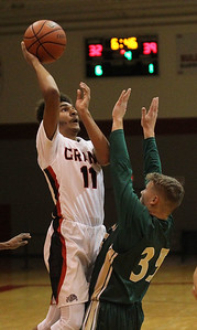 Candace H. Johnson-For Shaw Media Grants Torren Curry puts up a shot against Boylan's CJ Couper in the fourth quarter during the Grant Boys Basketball Thanksgiving Tournament in Fox Lake. Boylan won 56-49. (11/19/18)