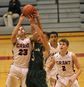 Candace H. Johnson-For Shaw Media Grant's Henry Kusiak gets his shot blocked by Boylan's Johnny Close in the third quarter during the Grant Boys Basketball Thanksgiving Tournament in Fox Lake. Boylan won 56-49. (11/19/18)