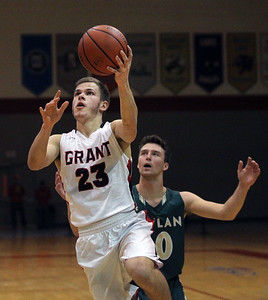 Candace H. Johnson-For Shaw Media Grant's Henry Kusiak leaps up for a shot past Boylan's Jake Bergstrom in the third quarter during the Grant Boys Basketball Thanksgiving Tournament in Fox Lake. Boylan won 56-49. (11/19/18)