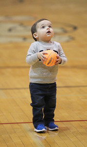Candace H. Johnson-For Shaw Media Weston Bosworth, nineteen-months-old, of Antioch looks up at the basket with his basketball as he plays on the court at half-time as Grant plays against Boylan during the Grant Boys Basketball Thanksgiving Tournament in Fox Lake. Weston is the son of Grant's head coach of varsity boys basketball, Wayne Bosworth. (11/19/18)