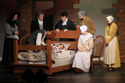 Candace H. Johnson-For Shaw Media Reverend John Hale (Deon Lopez) looks at Betty Parris (Lizandra Barajas) as she is sick in bed during the fall play called, The Crucible, by Arthur Miller (which is based on the Salem witch trials) at Grant Community High School in Fox Lake. (11/18/18)