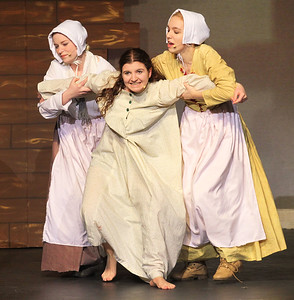 Candace H. Johnson-For Shaw Media Mercy Lewis (Alaska Field) and Abigail Williams (Faith Smith) hold on to Betty Parris, (Lizandra Barajas) center, as she tries to fly away during the fall play called, The Crucible, by Arthur Miller (which is based on the Salem witch trials) at Grant Community High School in Fox Lake. (11/18/18)