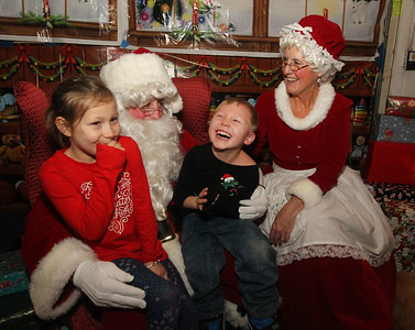 Candace H. Johnson-For Shaw Media Abigail Doering, 7, of Grayslake and her brother, Nathanael, 5, share a laugh with Santa and Mrs. Claus at the Oasis during Grayslake's Tree Lighting Festivities in downtown Grayslake. (11/23/18)
