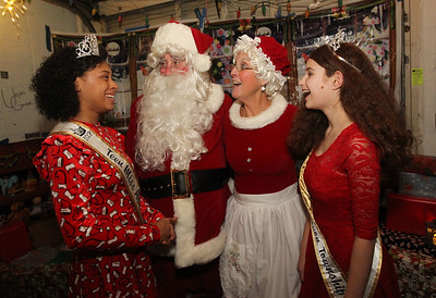 Candace H. Johnson-For Shaw Media Rose Garay, 14, of Grayslake, Teen Miss Avon Township, and Nicole Lieberman, 12, of Round Lake Beach, Junior Miss Avon Township, share a laugh with Santa and Mrs. Claus at the Oasis during Grayslake's Tree Lighting Festivities in downtown Grayslake. (11/23/18)