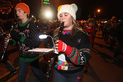 Candace H. Johnson-For Shaw Media Kaysee Williams, 17, of Ingleside (on right) plays her clarinet with the Grant Community High School's Marching Bulldogs as they make their way down Grand Avenue during the Fox Lake Festival of Lights Parade. (11/24/18)