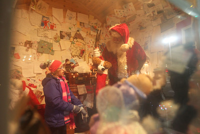 Candace H. Johnson-For Shaw Media DeAnna Clark, 9, of Round Lake talks with Santa in the Santa House at Millennium Park during Fox Lake Festival of Lights. The Fox Lake Santa House is open Friday, November 30th from 6-8 pm, Sunday, December 2nd from noon to 3:00 pm. and weekends until Christmas. Check www.foxlake.org for weekend hours.(11/24/18)