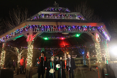 Candace H. Johnson-For Shaw Media The Merry Maskers sing Christmas carols at the gazebo after the Holiday Tree Lighting in Millennium Park during Fox Lake Festival of Lights. (11/24/18)