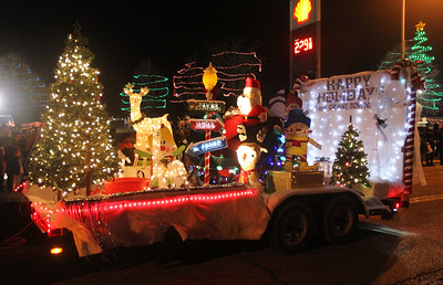 Candace H. Johnson-For Shaw Media The Grant Township float makes its way down Grand Avenue during the Fox Lake Festival of Lights Parade. (11/24/18)