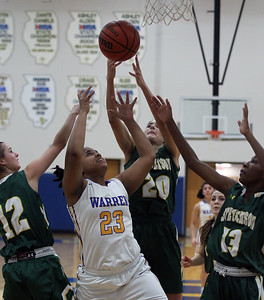 Candace H. Johnson-For Shaw Media Warren's Trenise Powe (#23) fights for a rebound against Stevenson's Kristin Hill, Avery King and Simone Sawyer in the second quarter at Warren Township High School in Gurnee. Stevenson won 58-32. (11/27/18)
