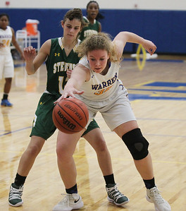 Candace H. Johnson-For Shaw Media Warren's Dana Lundtveit keeps the ball from going out against Stevenson's Kristin Hill in the fourth quarter at Warren Township High School in Gurnee. Stevenson won 58-32. (11/27/18)