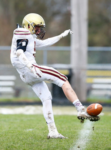 Saint Ignatius' Declan Callahan (9) punts the ball as the Cary-Grove Trojans defeat the St. Ignatius (Chicago) Wolfpack 41013 in a Class 6A IHSA football playoff game on Saturday, November 2, 2019, in Cary, Ill.
