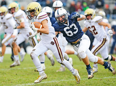 Cary-Grove's Zachary Petko (63) closes in for a tackle against Saint Ignatius' Jake Lo (8) as the Cary-Grove Trojans defeat the St. Ignatius (Chicago) Wolfpack 41013 in a Class 6A IHSA football playoff game on Saturday, November 2, 2019, in Cary, Ill.