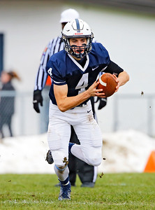 Cary-Grove's Lukas Eleftheriou (4) scrambles with the ball as the Cary-Grove Trojans defeat the St. Ignatius (Chicago) Wolfpack 41013 in a Class 6A IHSA football playoff game on Saturday, November 2, 2019, in Cary, Ill.